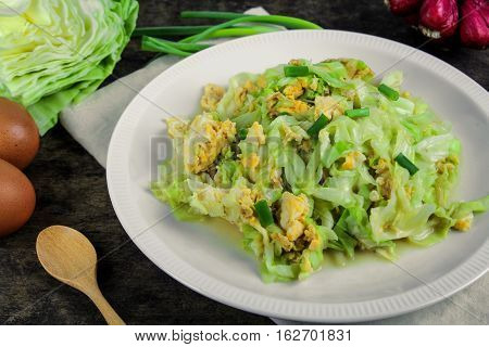 fried cabbage with egg and spring onion, healthy food