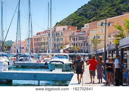 Tourists Walk In Bonifacio, Corsica