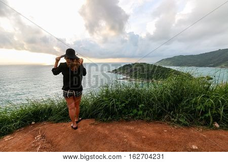 Woman standing with composed at Prom Thep cape the signature of Phuket