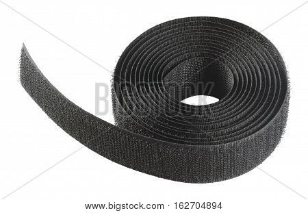 Hook and loop part fastening system. The fabric strip roll with tiny hooks. Object is isolated on white background without shadows