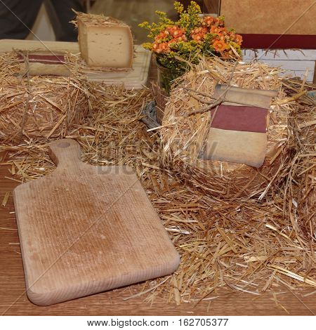 Aged Pecorino Cheese Cover with Decorative Straw and Wooden Cutting Board