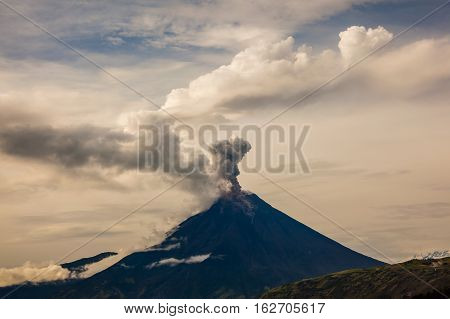The Tungurahua volcano erupting in the morning