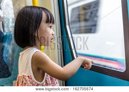 Asian Chinese Little Girl Inside Train Looking Beside The Window