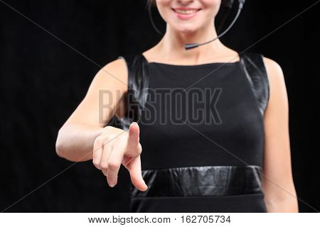 woman in front of visual touch screen.