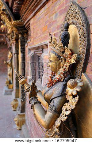 PATAN, NEPAL: Sculpture of the Goddess Mul Chowk at the Royal Palace, Durbar Square