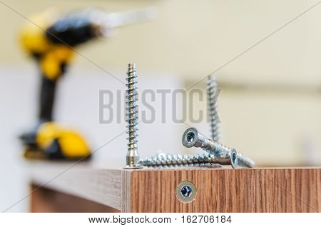 the process of furniture assembly screws closeup