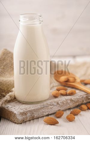 Almond milk nuts napkin on a stand vertical