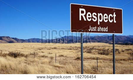Respect brown road sign with blue sky and wilderness