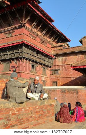 PATAN, NEPAL - DECEMBER 21, 2014: Two Nepalese men discussing at Durbar Square