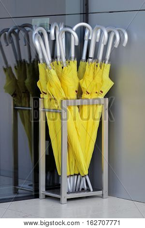 silver metal basket with yellow umbrellas with silver handles