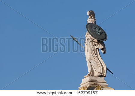 classical Athena statue from side, blue sky