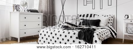 Light Bedroom With Patterned Bedding