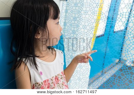 Asian Chinese Little Girl Sitting Inside A Mrt Transit