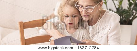 Grandma Reading To Little Grandchild