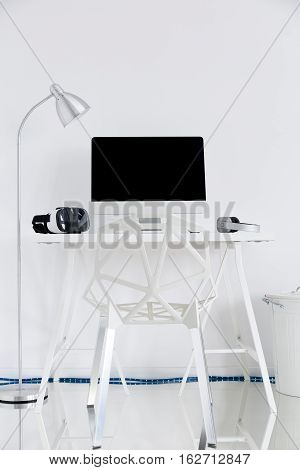 White Study With A Computer, A Lamp And A Gap Chair