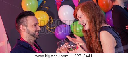 Young couple attending together the new year party