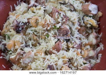 basmati rice with sea salad with squids and clams