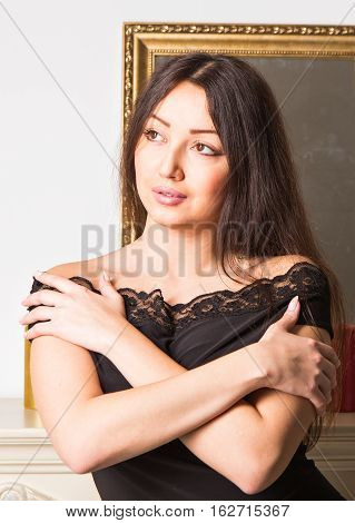 Gorgeous brunette woman in a luxurious classic interior. Beauty, fashion
