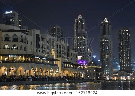 DUBAI, UAE - DEC 10: Souk Al Bahar in Dubai, UAE, as seen on Dec 10, 2016. It is an Arabic-style shopping mall with antique, carpet and lifestyle stores, plus waterfront dining.