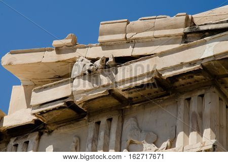 CLOSE UP OF HORSES IN THE EAVES OF THE PARTHENON ON THE ACROPOLIS IN ATHENS, GREECE