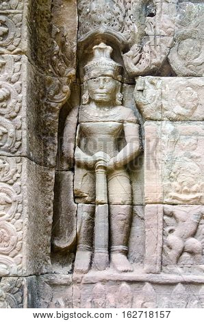 A carved guardian spirit at the entrance of Ta Som Temple in Siem Reap Cambodia.