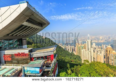 Hong Kong, China - December 7, 2016: The Peak Tower and rooftop restaurant atop Victoria Peak in a sunny day. The Peak Tower and spectacular views of Victoria Harbour and skyline of Hong Kong.
