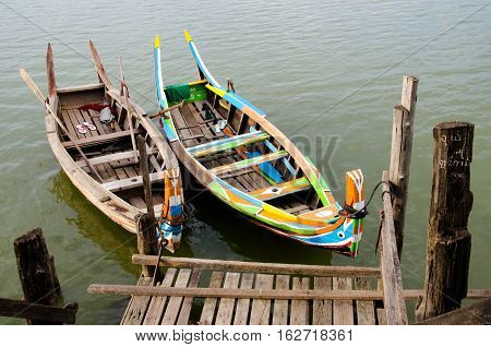Boats docked at the Taung Tha Man Lake in Mandalay Myanmar