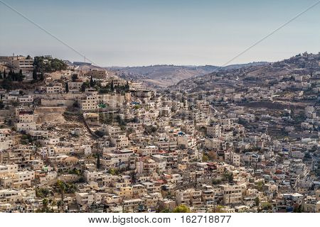View of the Village of Siloam from the opposite hill neighborhood of Silwan outside the walls of the Old City of Jerusalem Israel