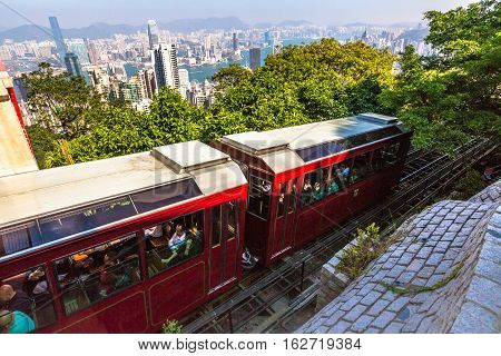 Hong Kong, China - December 10, 2016: The Peak Tram is a funicular railway in Hong Kong leading to the highest point of the island: the Victoria Peak.