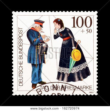 GERMANY - CIRCA 1993 : Cancelled postage stamp printed by Germany, that shows Postman and woman.
