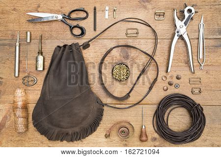 Leather craft tools and the hand made leather bag