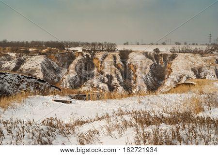 Winter geological landscape - soil erosion in ravine