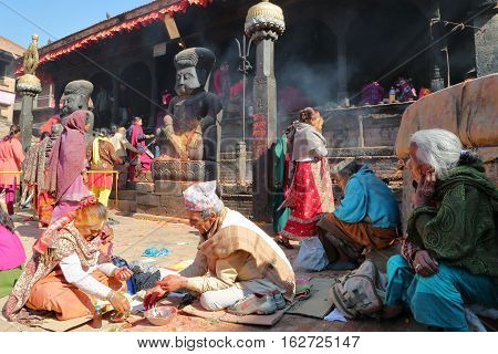 BHAKTAPUR, NEPAL - DECEMBER 31, 2014: Hinduist ceremony at Dattatreya temple in Bakhtapur, Nepal
