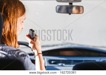 Young Man Driving Car Using Cb Radio