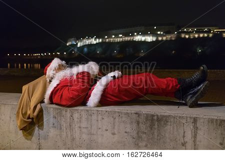 Santa Claus Sleeping And Relaxing After Long Night Of Work.