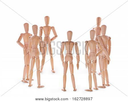 Wooden dummies characters group on white. Discussion meeting and teamwork concept