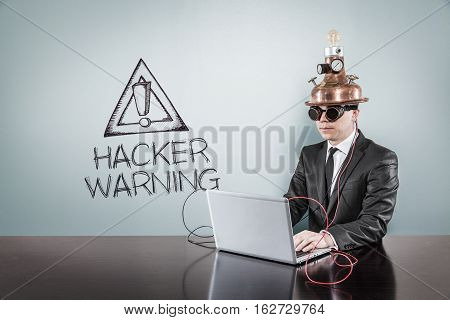 Hacker warning text with vintage businessman using laptop at office