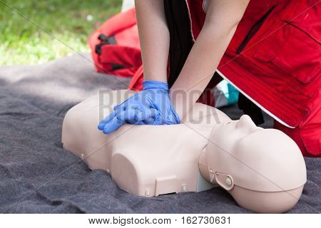 First aid training. Instructor showing Cardiopulmonary resuscitation - CPR on training doll.