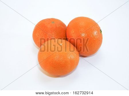 Mandarins are isolated on a white background. Three mandarin