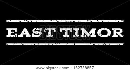 East Timor watermark stamp. Text caption between horizontal parallel lines with grunge design style. Rubber seal stamp with scratched texture. Vector white color ink imprint on a black background.