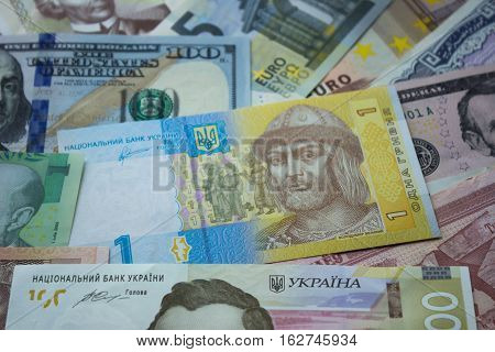Ukrainian hryvnia dollar bills euros and other money. Money background