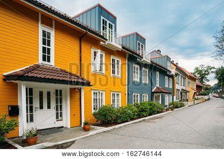 Bergen, Norway. The Colorful Facades Of Houses On Deserted Street At Residential Area In Summer Day Under Somber Sky.