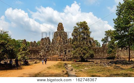 Siem Reap, Cambodia - February 2, 2016: Unidentified tourists visit to Prasat Bayon in Angkor Thom Complex, Siem Reap, Cambodia. Ancient Khmer architecture famous Cambodian landmark World Heritage