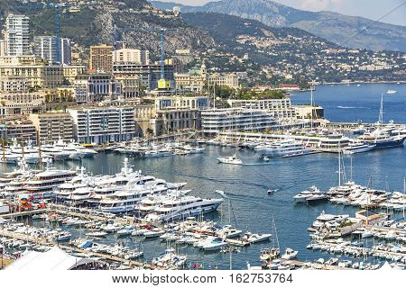 Monte Carlo city skyline panorama. Close-up view of luxury yachts and apartments in harbor of Monte Carlo Monaco Cote d'Azur