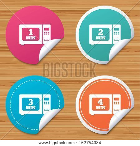 Round stickers or website banners. Microwave oven icons. Cook in electric stove symbols. Heat 1, 2, 3 and 4 minutes signs. Circle badges with bended corner. Vector
