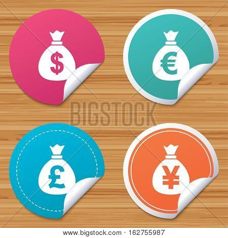 Round stickers or website banners. Money bag icons. Dollar, Euro, Pound and Yen symbols. USD, EUR, GBP and JPY currency signs. Circle badges with bended corner. Vector