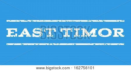 East Timor watermark stamp. Text tag between horizontal parallel lines with grunge design style. Rubber seal stamp with unclean texture. Vector white color ink imprint on a blue background.