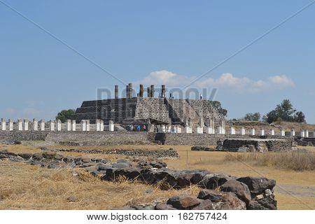 Amongst the ruins stand Atlantean Toltec warrior  Figures  on top of a pyramid  in Tula de Allende, Hidalgo, Mexico