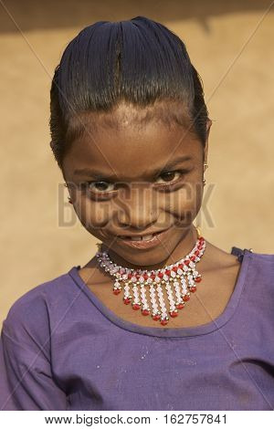 MANDU, MADHYA PRADESH, INDIA - NOVEMBER 19, 2008: Portrait of a young girl in the rural hilltop fortress of Mandu in Madhya Pradesh, India