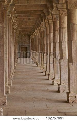 MANDU, MADHYA PRADESH, INDIA - NOVEMBER 18, 2008: Cloisters in the ancient tomb of Hoshang Shah in Mandu, Madya Pradesh, India. 15th Century AD